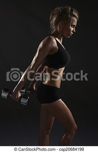 Sexy woman doing physical exercise with dumbbells - csp20684199