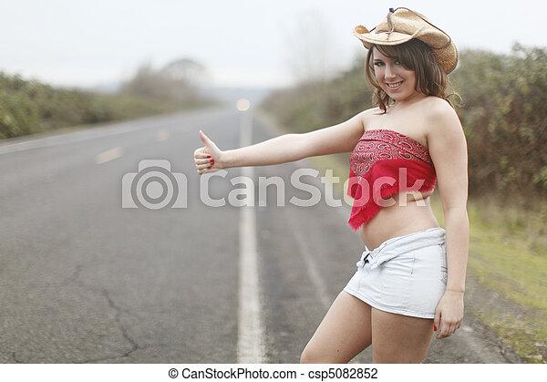 Sexy woman hitchhiking - csp5082852