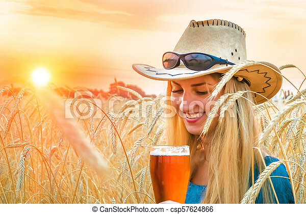 sexy woman in barley holds a glass of stock image csp57624866