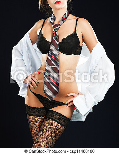 Sexy woman in erotic lingerie over dark background - csp11480100
