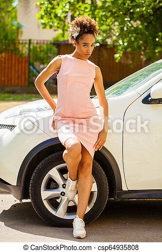 Sexy woman in pink dress posing - csp64935808