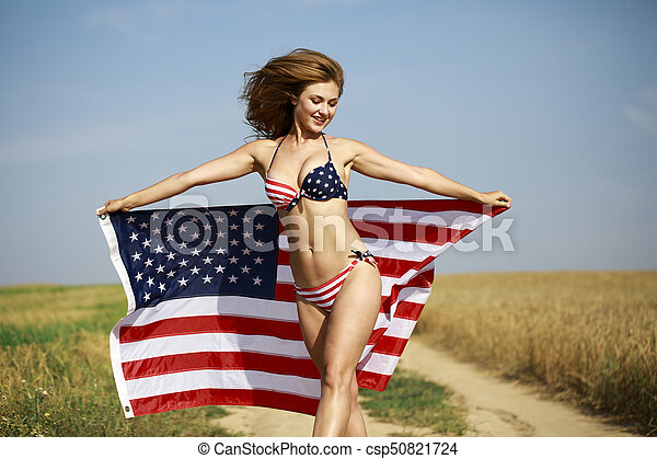 08ffa843aadac Sexy woman in sexy American flag bikini in a wheat field - csp50821724