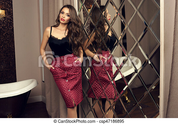 Sexy woman in top and skirt - csp47186895