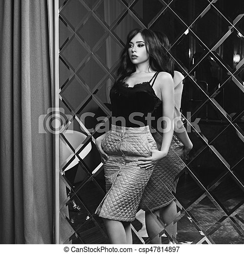 Sexy woman in top and skirt - csp47814897