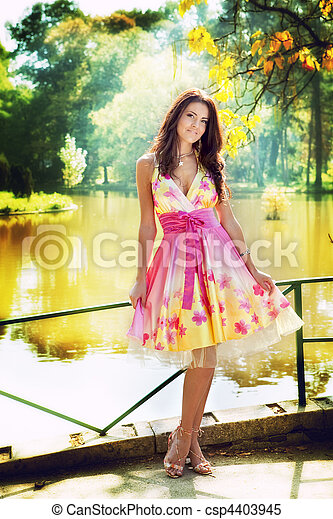 Sexy woman outdoor with colorful dress - csp4403945