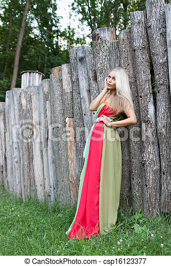 Sexy woman outdoor with nice colorful dress - csp16123377