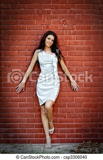Sexy young elegant woman over brick wall - csp3306040