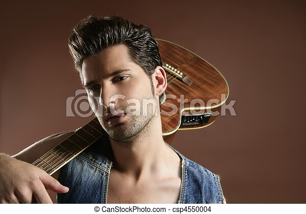 sexy young man musician guitar player on brown - csp4550004