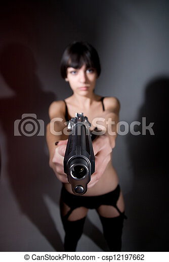 Sexy young woman with a gun  - csp12197662