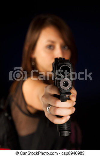 Sexy young woman with a gun - csp8946983