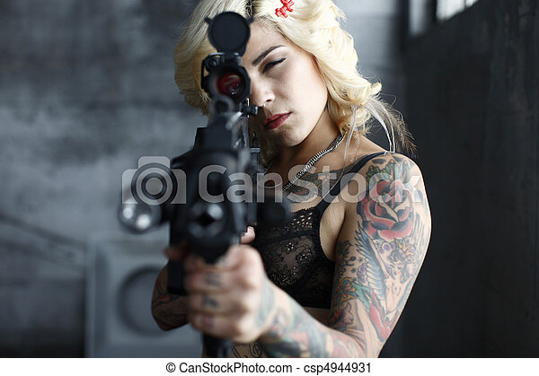 Sexy young woman with gun - csp4944931