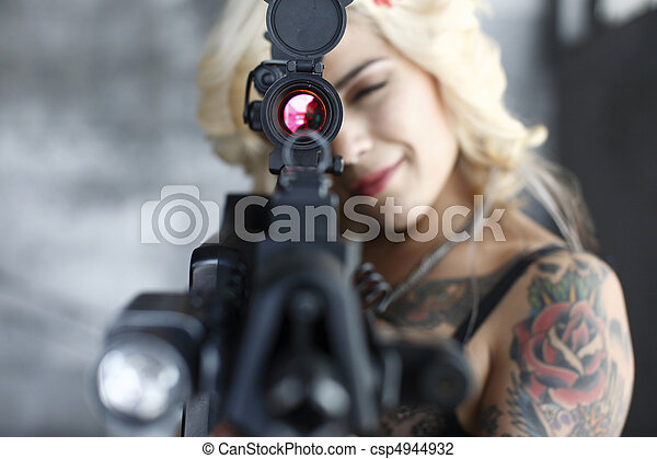 Sexy young woman with gun - csp4944932
