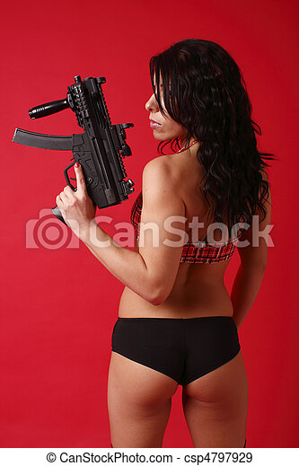 Sexy young woman with gun - csp4797929