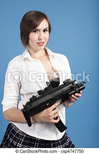 Sexy young woman with gun - csp4747750