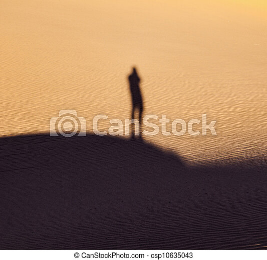 shadow of a man in the desert - csp10635043