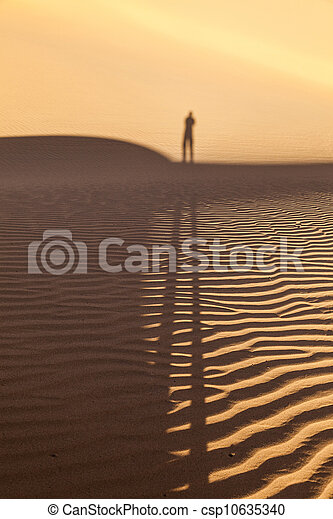 shadow of a man in the desert - csp10635340