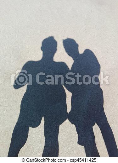 Shadows Long Shadows Of Two Friends On Beach Sand