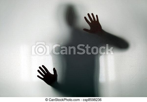 Shadowy figure behind glass - csp8598236