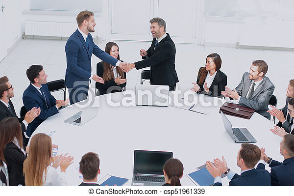 Shake Hands After Successful Negotiations. Round Table   Csp51961339
