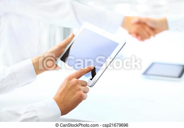 shaking hands in office - csp21679696
