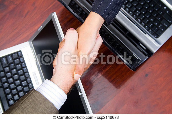 shaking hands on a deal - csp2148673