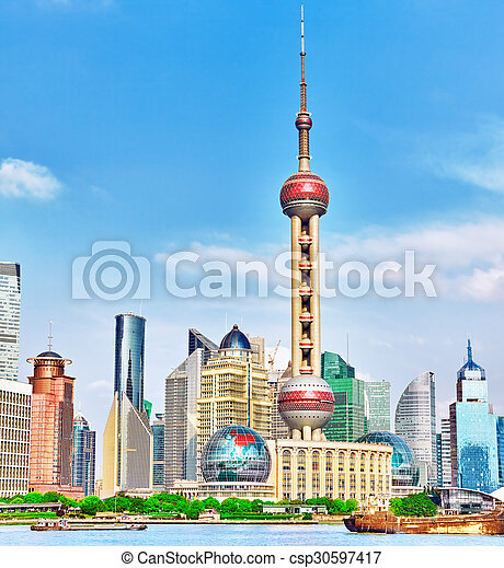 SHANGHAI-MAY 24, 2015. Oriental Pearl Tower on  blue sky background. Tower  470 meter the Oriental Pearl is one of Shanghai's tallest buildings, located at Lujiazui finance and trade zone in Pudong district in most dynamic city of China. - csp30597417