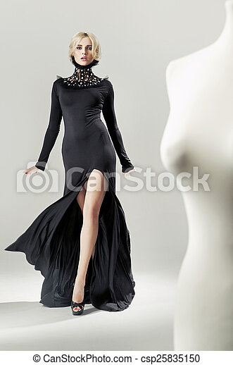 Shapely, alluring blond lady in black gown - csp25835150