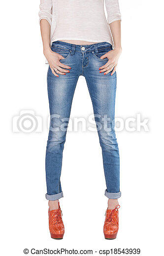 f343e7f7cf Shapely female legs dressed in blue jeans and orange boots with high ...
