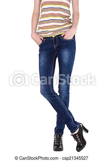 Shapely female legs dressed in dark blue jeans - csp21345527