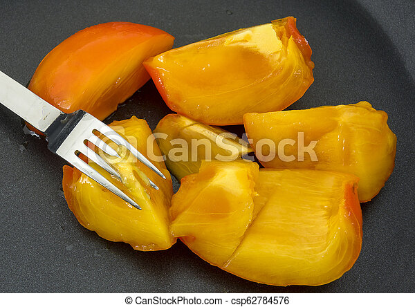 Sharon fruit with fork - csp62784576