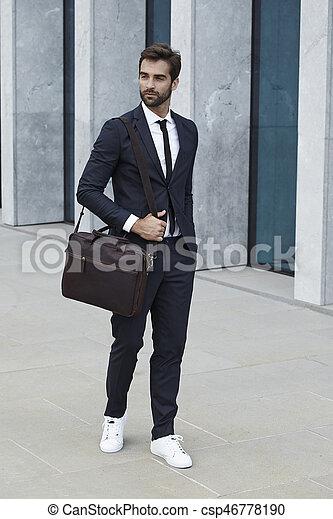 sharp businessman with briefcase