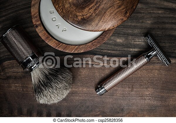 Shaving accessories on a luxury wooden background - csp25828356