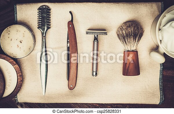 Shaving accessories on a luxury wooden background - csp25828331