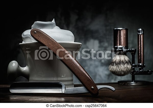 Shaving razors and bowl with foam on wooden background - csp25647064