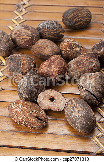 shea nuts near butter on white background - csp27071310