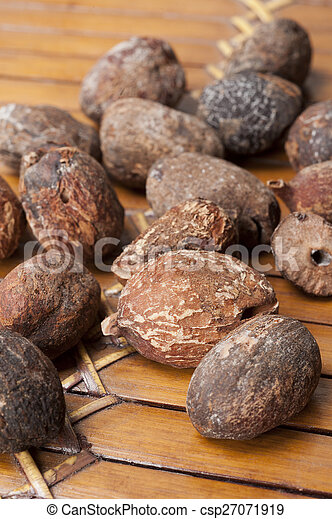 shea nuts near butter on white background - csp27071919