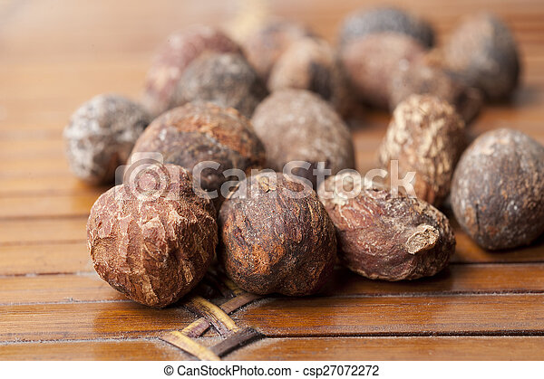 shea nuts near butter on white background - csp27072272