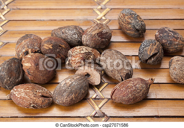 shea nuts near butter on white background - csp27071586