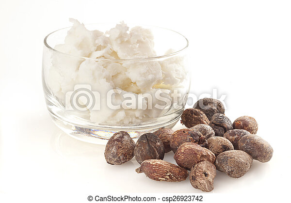 shea nuts near butter on white background - csp26923742