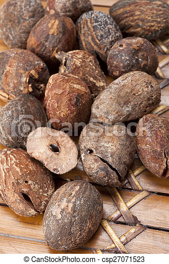 shea nuts near butter on white background - csp27071523