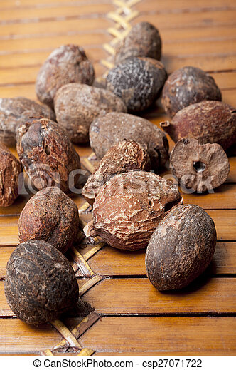 shea nuts near butter on white background - csp27071722