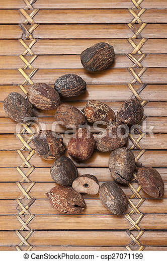 shea nuts near butter on white background - csp27071199