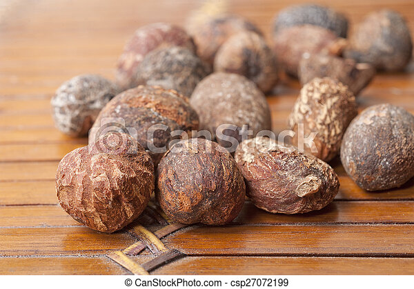 shea nuts near butter on white background - csp27072199
