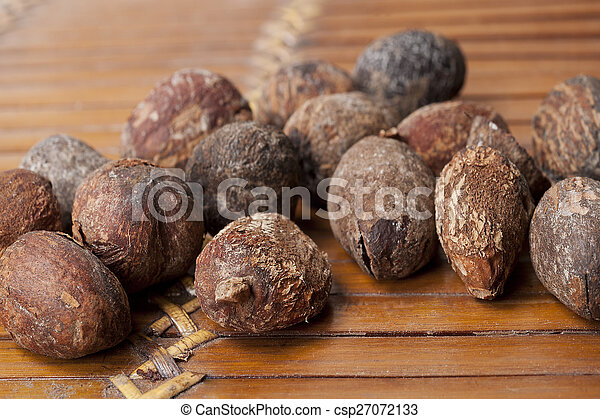 shea nuts near butter on white background - csp27072133