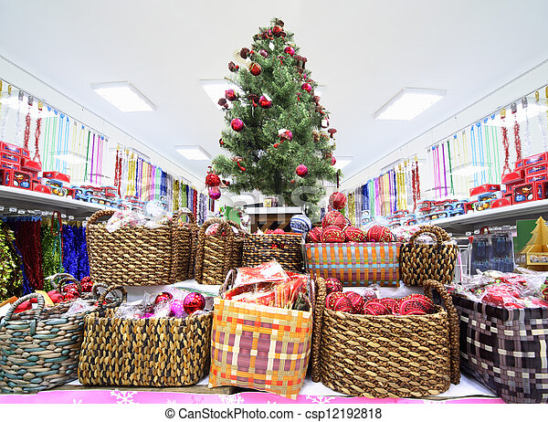 shelves with variety of christmas tree decorations inside large supermarket csp12192818