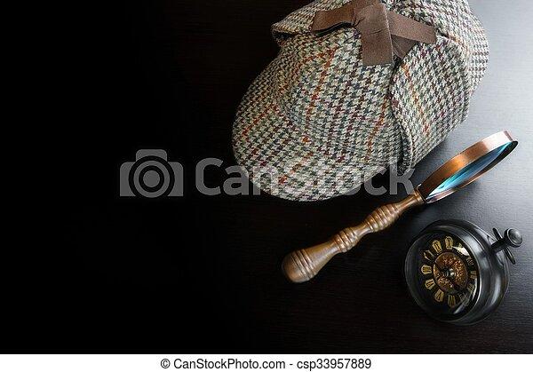 Sherlock Deerstalker Hat,  Vintage Clock And Magnifier On Black Table - csp33957889