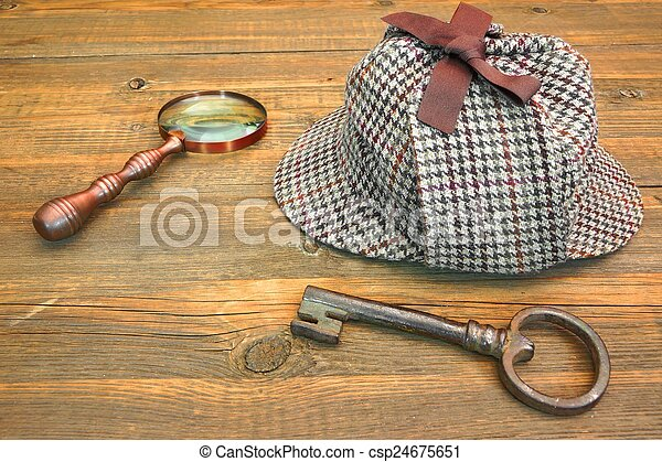 Sherlock Holmes Cap famous as Deerstalker, Old Key and Magnifier - csp24675651