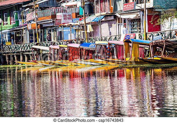 Shikara boat in Dal lake , Kashmir India - csp16743843
