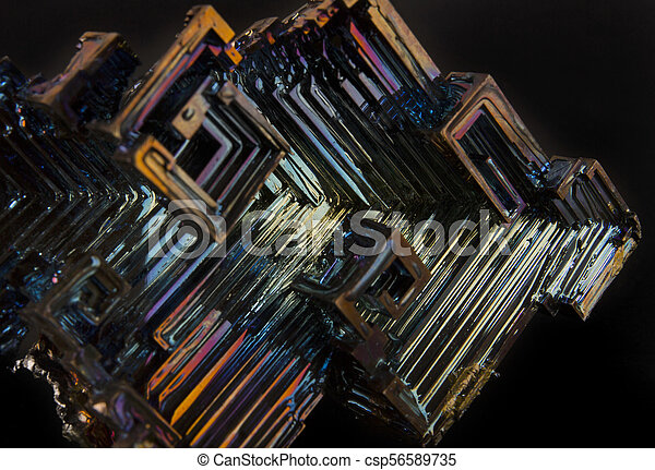 Shiny colorful mineral bismuth on a dark background - csp56589735