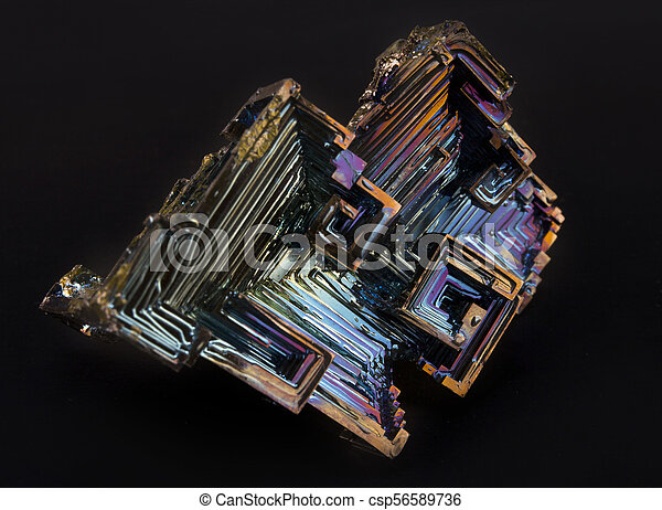 Shiny colorful mineral bismuth on a dark background - csp56589736